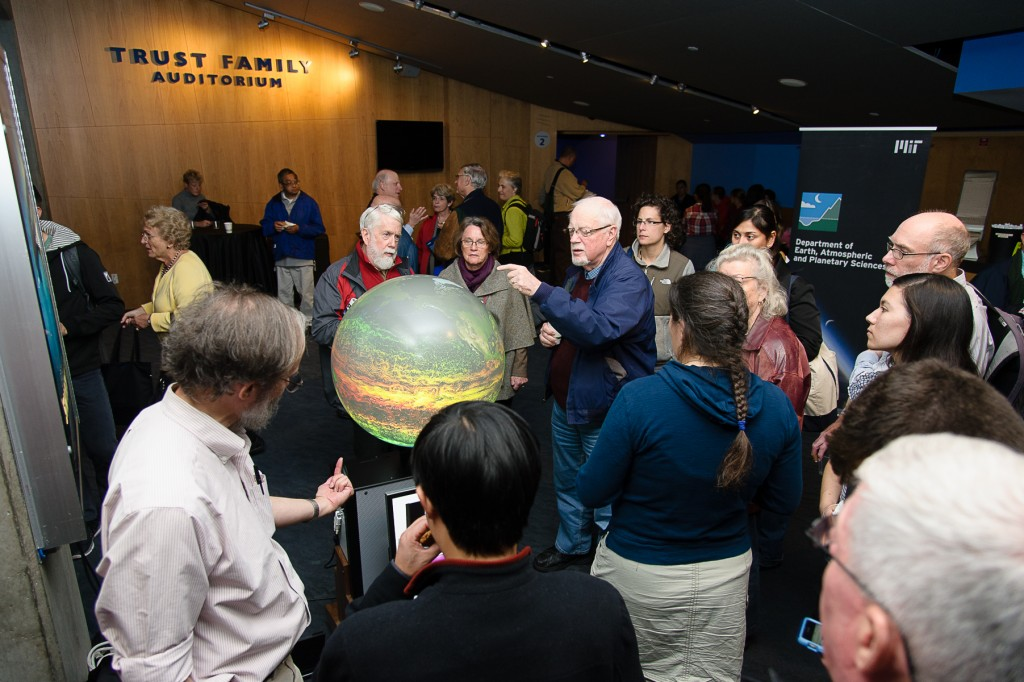 Guests gather around the iGlobe and talk with MIT scientists about atmospheric circulation. Credit: John Gillooly