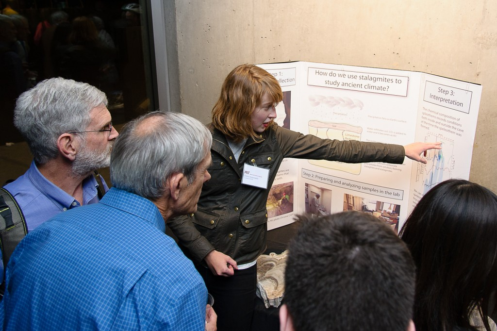 Graduate student Elena Steponaitis describes how her lab studies paleo-climate from minerals. Credit: John Gillooly