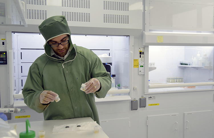 Adam Sarafian preps samples in Sune Nielsen's NIRVANA clean lab to remove all contamination from the surface prior to analysis (Photo: Jayne Doucette, Woods Hole Oceanographic Institution)