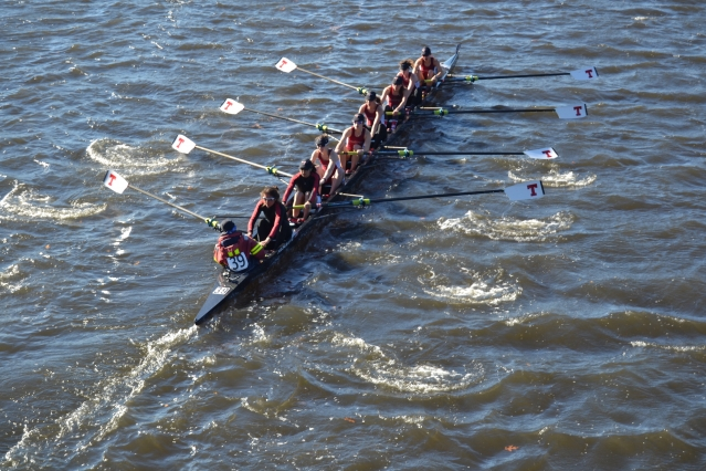 To the cheers of teammates and family on the Weeks Footbridge, the Varsity 8 row by in synch, steadily gaining on Princeton University at the Head of the Charles Regatta. Along with a four-rower boat in lightweight women's crew, the MIT rowers are about to make program history. Left to right: Chloe Thacker (coxswain), Priya Veeraraghavan (captain), Sharon Wu (captain), Elizabeth Martin, Annika Rollock, Valerie Hunter, Michelle Lauer, Kelly Barton, and Sylvia Sarnik (Photo: Sam Hunter Magee/Arts at MIT)
