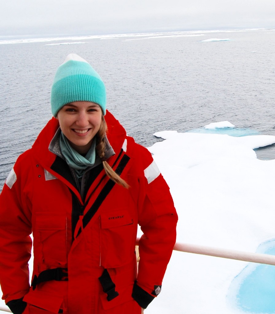 "MIT-WHOI graduate student Lauren Kipp wearing a ""mustang"" suit on an Arctic GEOTRACES cruise, on the USGCC (US Coast Guard Cutter) Healy in the Arctic Ocean, as they entered the zone of ice coverage. (Photo: Erin Black, MIT-WHOI Joint Program student)"