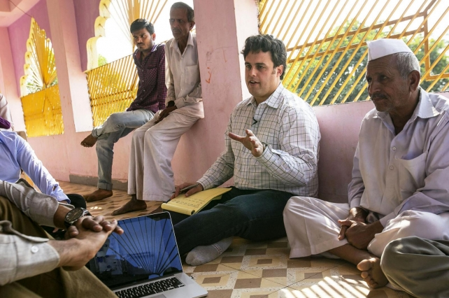 Amos Winter, assistant professor in the Department of Mechanical Engineering, speaks to individuals in India, where he has introduced assistive technologies such as a wheelchair for rugged terrain. (Photo: John Freidah/Department of Mechanical Engineering)