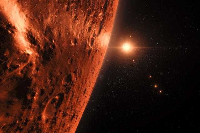 This artist's impression shows the view from the surface of one of the planets in the TRAPPIST-1 system. At least seven planets orbit this ultracool dwarf star 40 light-years from Earth and they are all roughly the same size as the Earth. Several of the planets are at the right distances from their star for liquid water to exist on the surfaces. (Image: ESO/N. Bartmann/spaceengine.org)