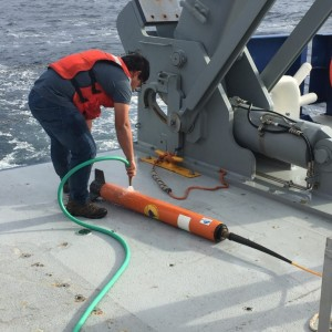 Washing seawater off of the magnetometer after recovery. (Photo by J.-A. Olive.)