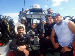 MIT-WHOI Joint Program students Laura Weber and Tyler Tamasi with Cuban scientists. (Photo: courtesy of Tyler Tamasi)