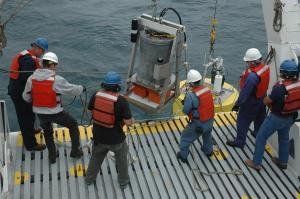 Researchers deploying the ESP to free-drift for three days of microbe sampling (credit: MBARI)